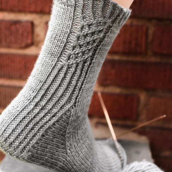 Gray cabled knit sock